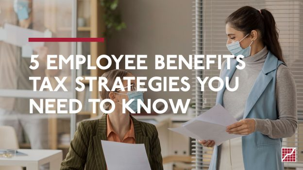 Tax Strategies You Need to Know   Two women working in a brightly lit office, both wearing masks.